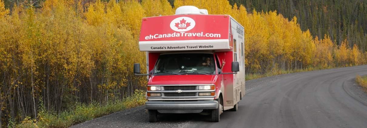 sign post forest alaska highway road trip