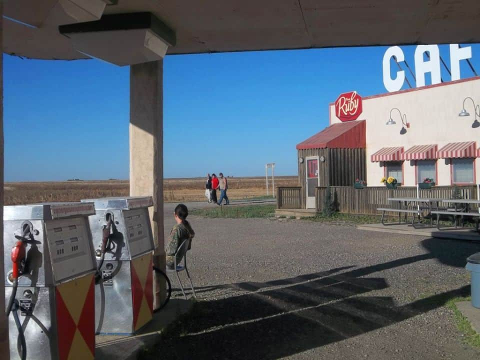 Andrea looks like the Gas Attendant as her 3 brothers walk by the RUBY Cafe on the set of Corner Gas<br />Rouleau, (AKA Dog River) Saskatchewan