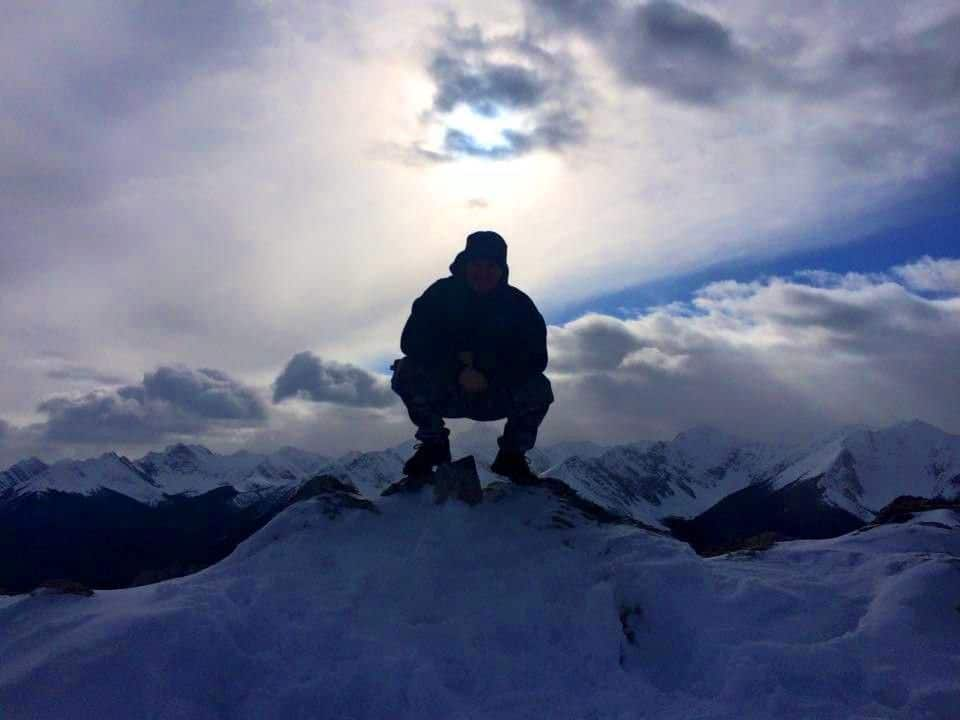 Brad on top of the world in the beautiful Rocky Mountains, Alberta, Canada