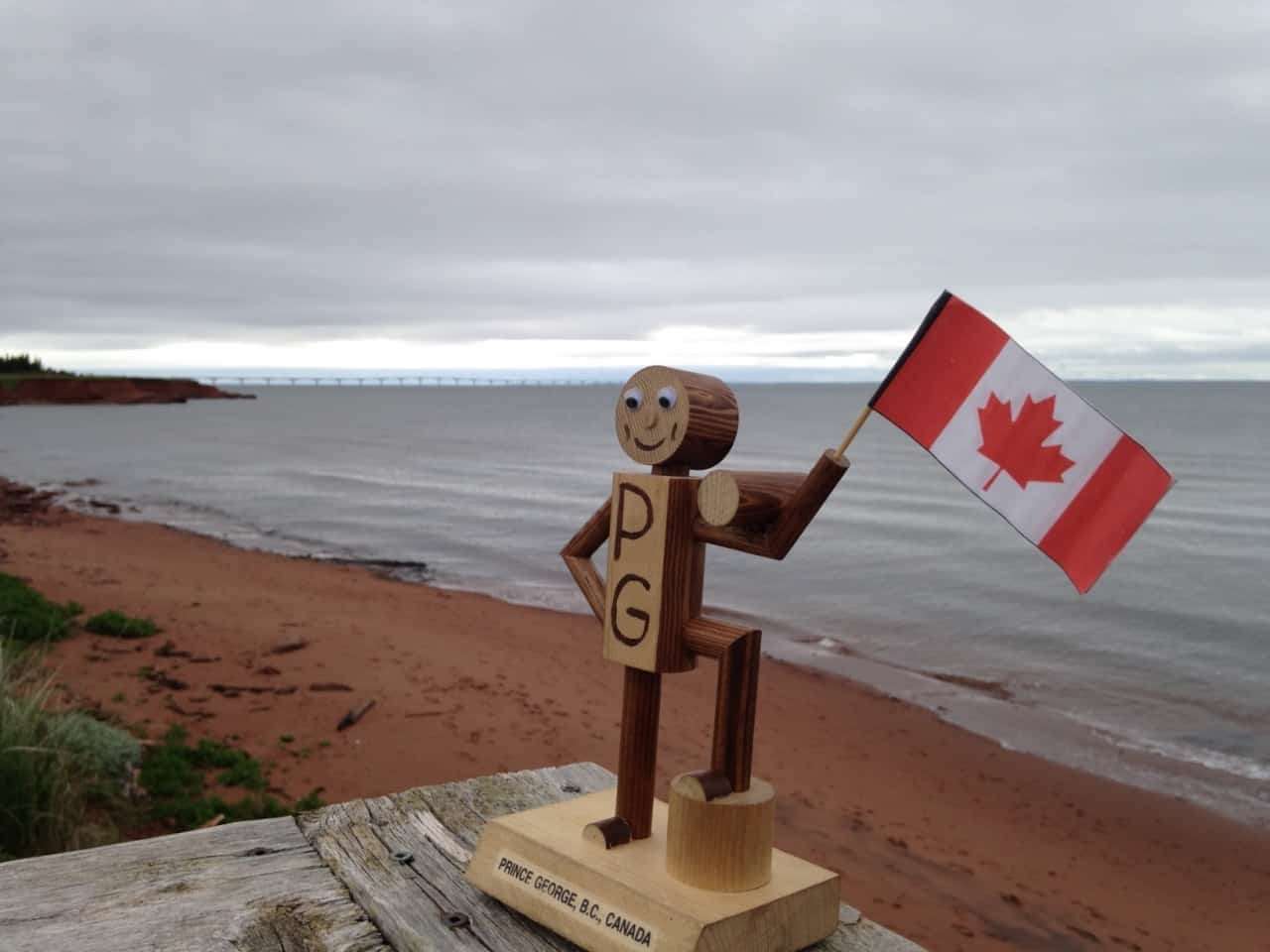 5df1816cb800b9204f6c6ebe.jpg - PEI - Across Canada in search of #BIGselfies trip 2014<br />The red sands of PEI and the confederation bridge in the background