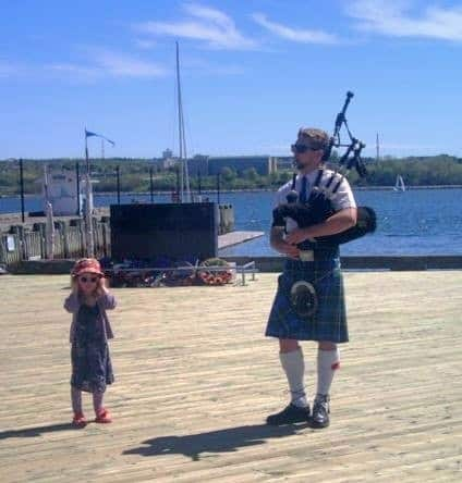 6f950fa5e008abbf18471d42.jpg - Not everyone loves the bagpipes - at Halifax Seaport.